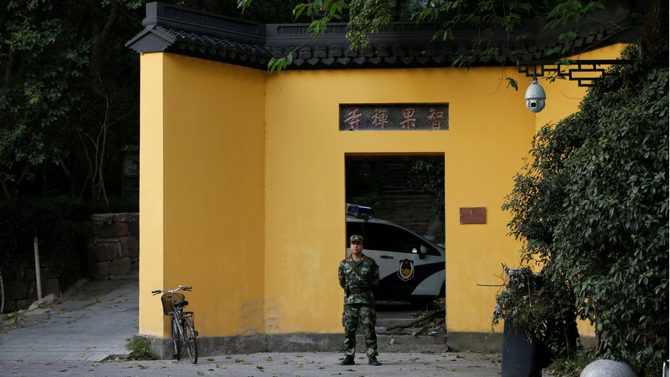 A paramilitary policeman stands in front of a temple near the West Lake, before the G20 Summit in Hangzhou, Zhejiang Province, China. 31 August 2016.