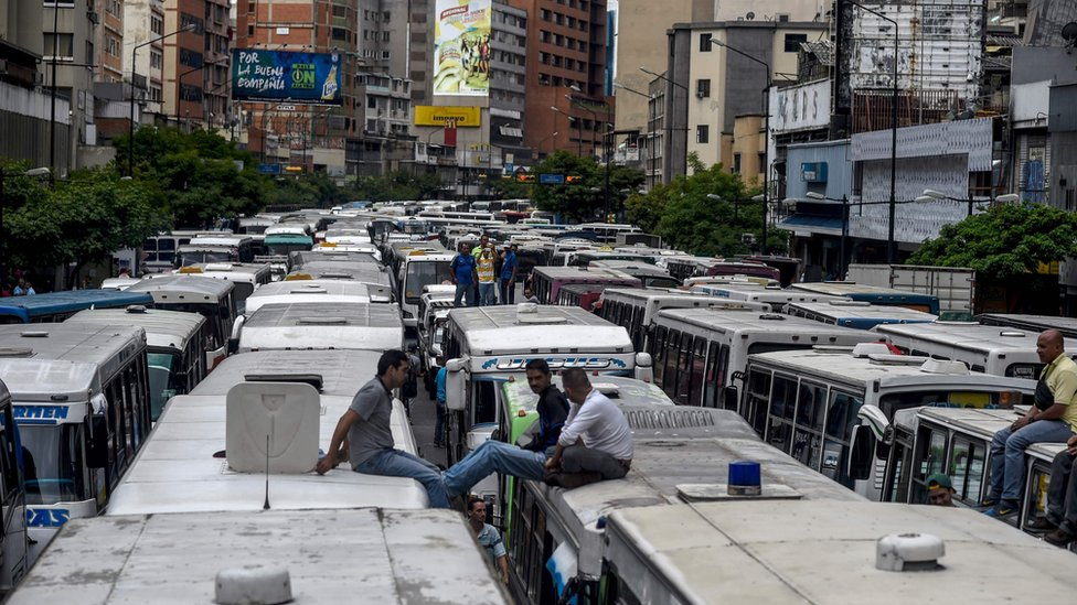 Street in Caracas blocked by buses during a protest by drivers due to the shortage of spare parts for their vehicles on 21 September