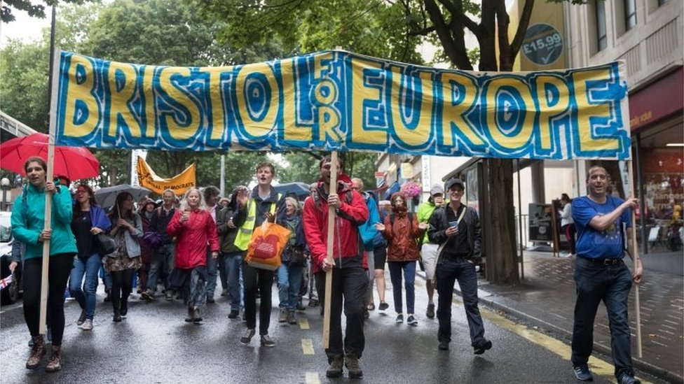 People march on a pro-EU demonstration through the city centre of Bristol