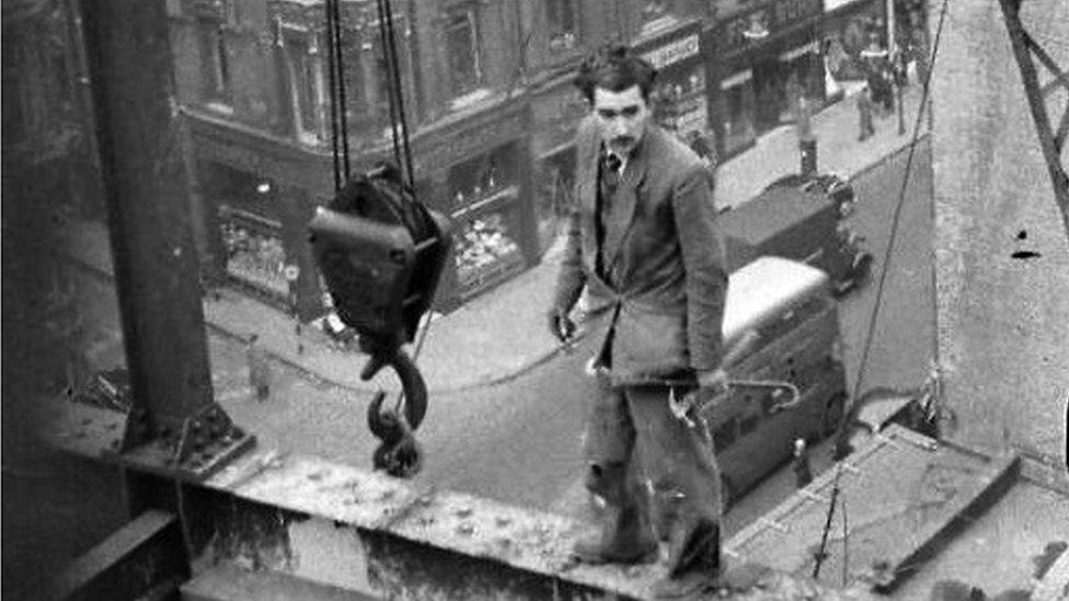 Fabian Cowan standing on scaffolding