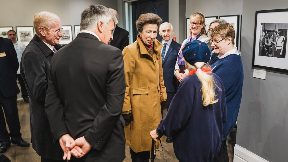 Princess Anne speaking to people in the House of Mannanan