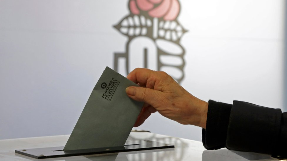 A woman votes in the second round of the French left's presidential primary election in Nice