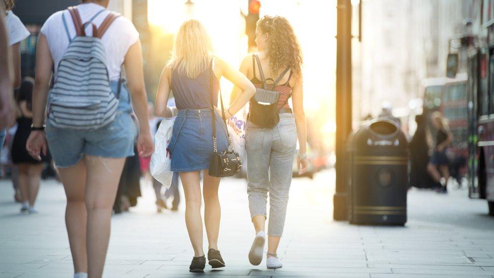 Young women walking down a street