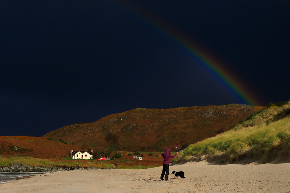Peter Buxton from East Yorkshire captured this image of Hannah playing with Moss and warming up between the hail showers at Camusdarach.