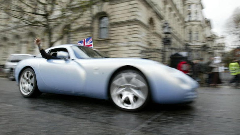 A man driving a TVR Tuscon