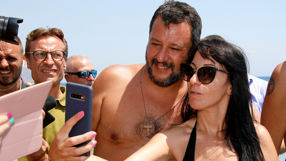 Mr Salvini and fan pose for a beach selfie in Taormina, 11 Aug 19
