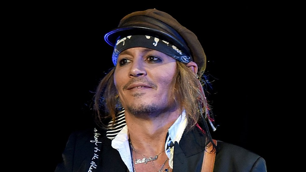 Johnny Depp settles lawsuit with former management