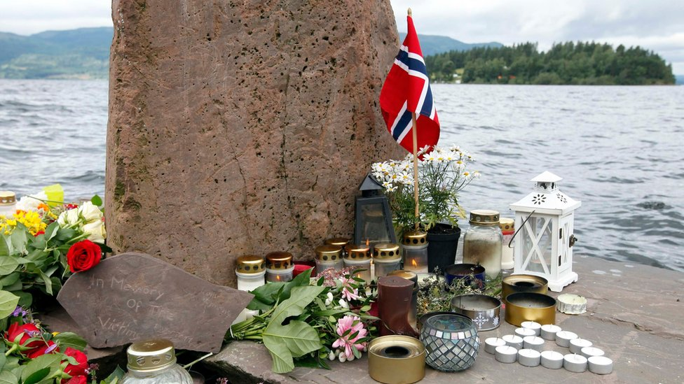 Flowers and candles are placed on the shore opposite to the Utoeya Island, Norway, 24 July 2011.