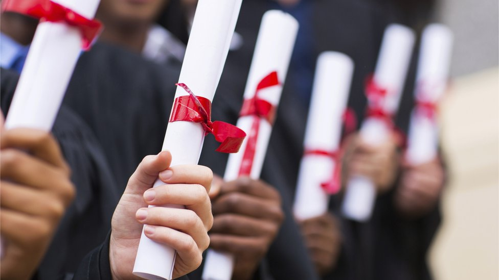 Students holding their scrolls