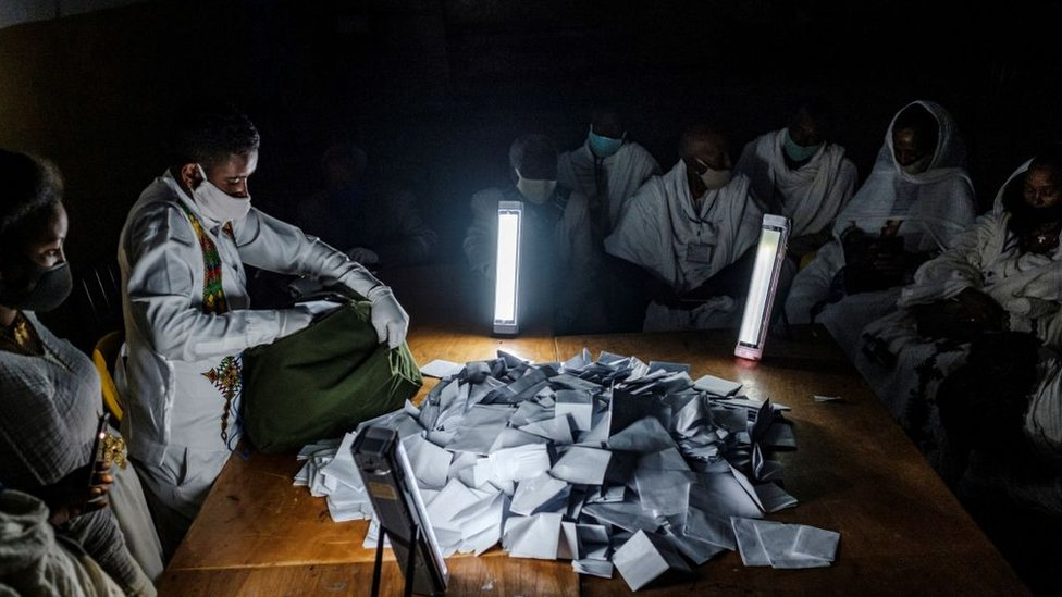 Electoral officials open a ballot box at a polling station on the day of Tigray's regional elections, on September 9, 2020 in Mekele.
