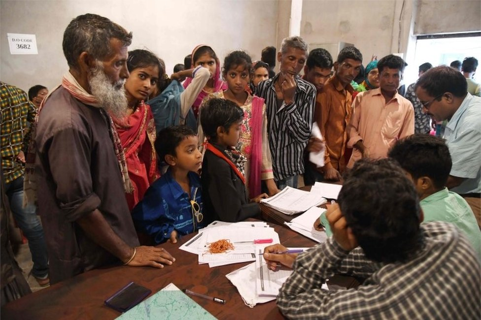 Assam State National Register of Citizens (NRC) officials check documents of Indian residents during AN appeal hearing against the non-inclusion of their names in the citizens register at a NRC office in Dhubri, some 261 kms from Guwahati