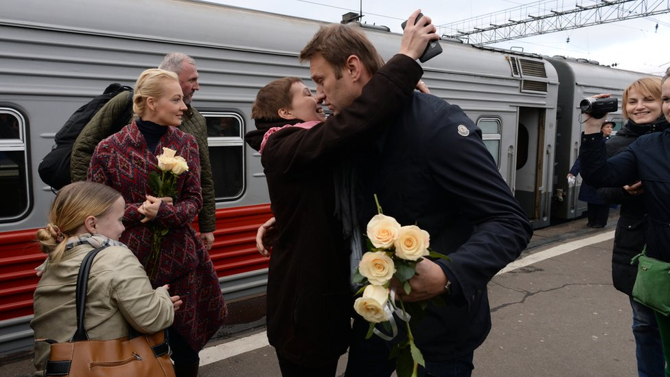Alexei Navalny returns from Kirov after his 5-year term was made a suspended sentence