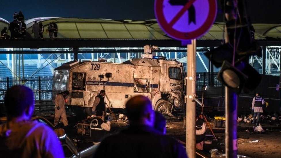 Forensic officers at the site where a car bomb exploded near the stadium of football club Besiktas in central Istanbul on December 10