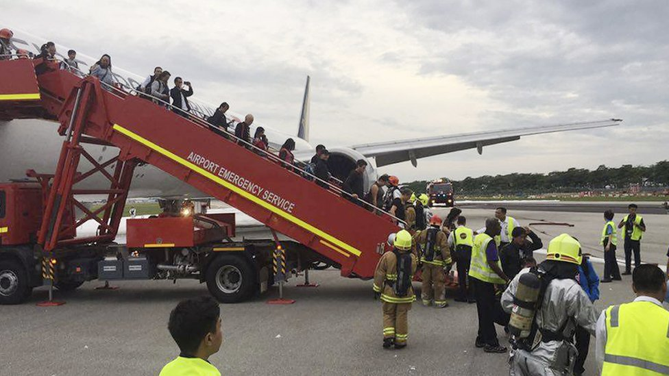 This image provided by Lee Bee Yee shows the aftermath of an engine fire on a Singapore Airlines flight, at Changi International Airport on Monday, June 27, 2016.
