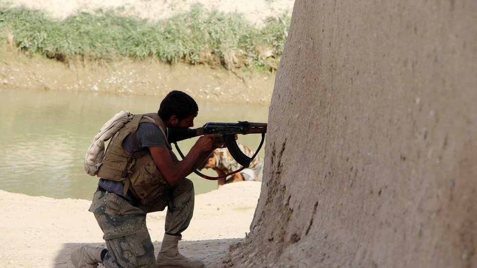 A member of the Afghan security service takes position during an operation in an area retaken from the Taliban, in Nawa district of Helmand province, Afghanistan, 18 April 2017