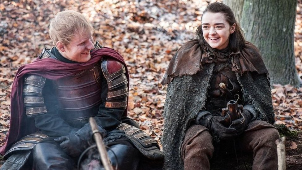 Undated handout photo issued by HBO of Ed Sheeran staring in the TV drama Game of Thrones, alongside Maisie Williams who plays Arya Stark.