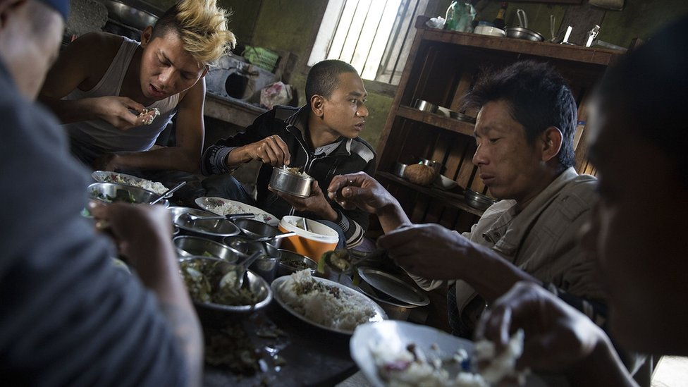 Pat Jasan members and detainees share a meal on 26 January 2016 in Myitkyina, Kachin state.