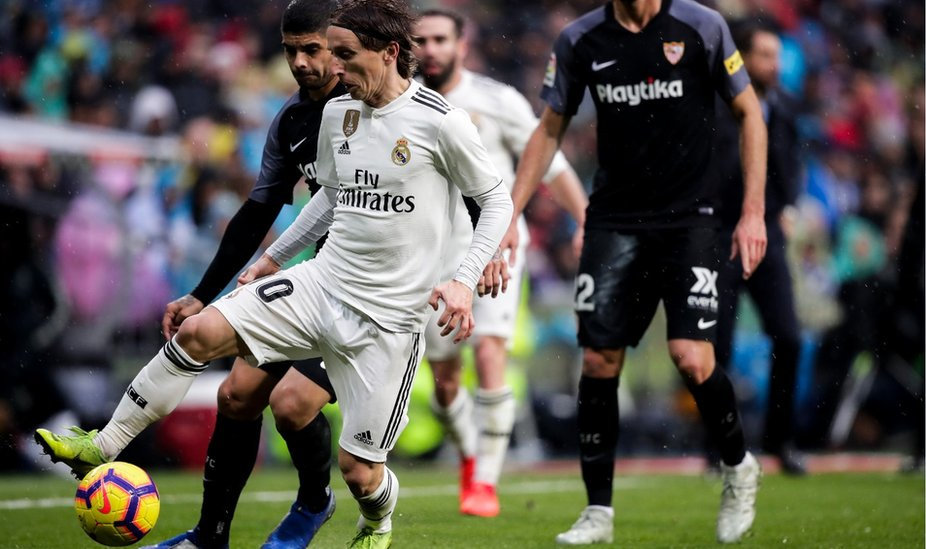 Luka Modric in action against Seville
