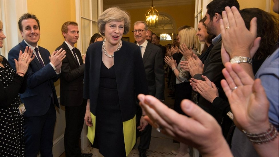 Theresa May is clapped into 10 Downing Street