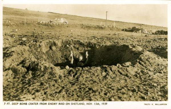 Man holding rabbit in bomb crater