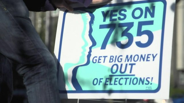 """Sign by activist Matthew Strieb asking for """"Big money"""" to be removed from elections"""