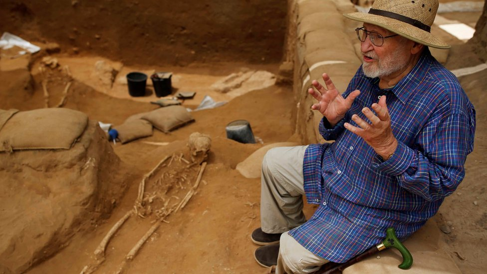 Professor Lawrence E. Stager, Dorot Research Professor of the Archaeology of Israel, speaks during an interview with Reuters near a partly unearthed skeleton at excavation site of the first-ever Philistine cemetery at Ashkelon National Park in southern Israel June 28, 2016.