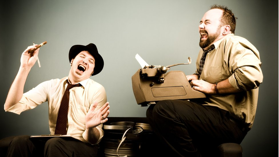 Two men laughing in glee