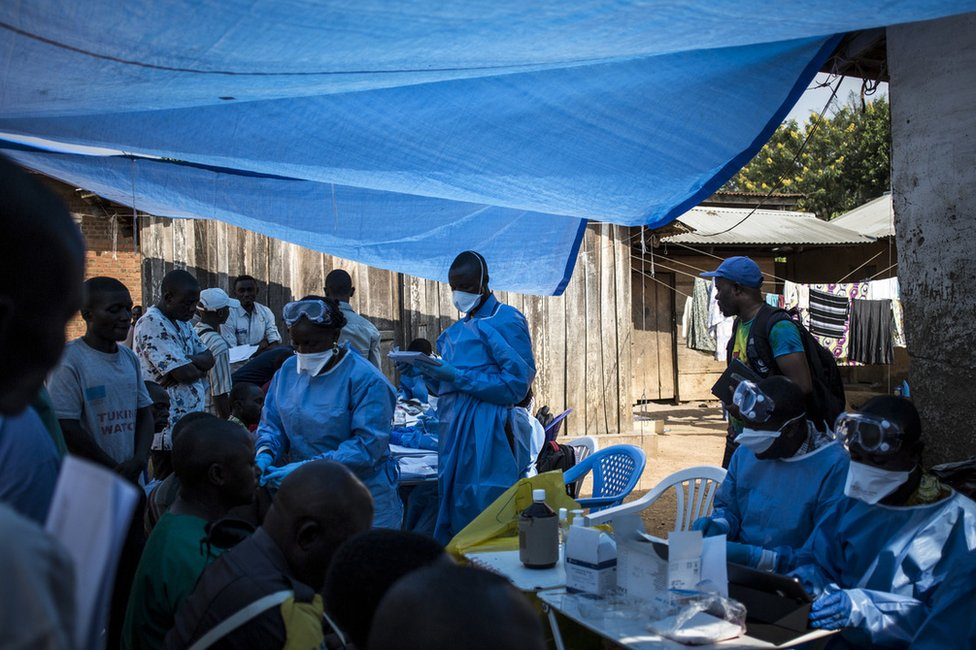 Medical workers administer the Ebola vaccine on 17 August in Mangina