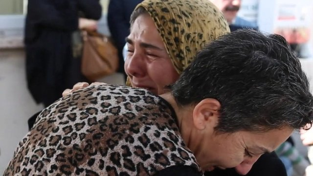 Relatives of victims console each other