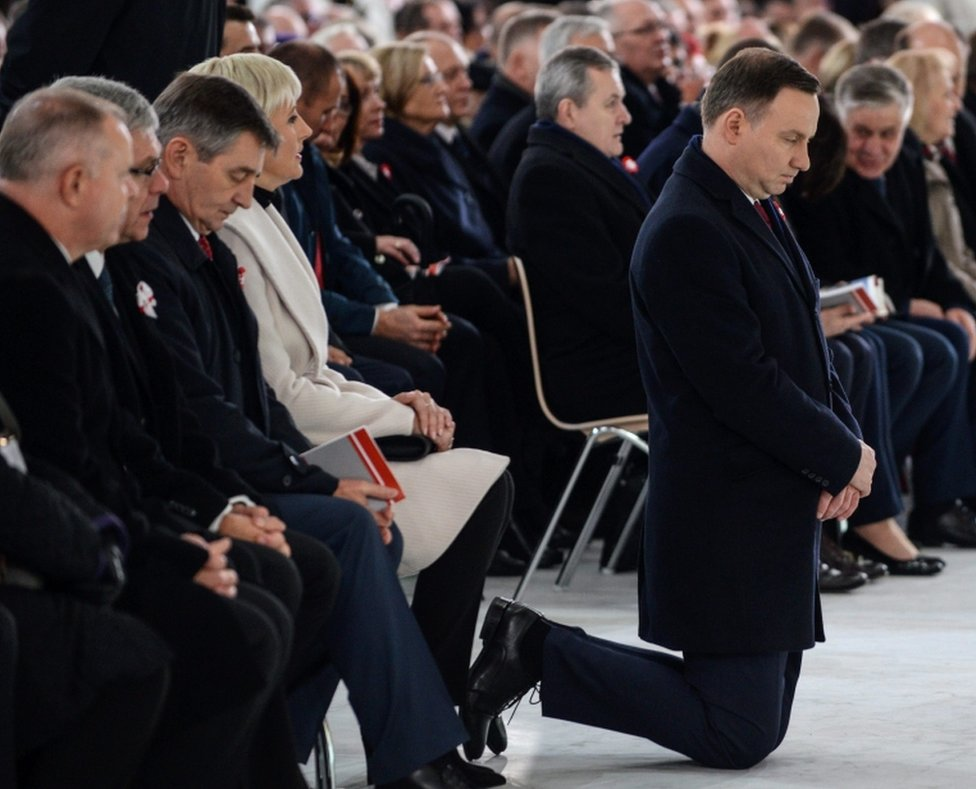 President of Poland Andrzej Duda (right) kneels as he prays with his wife Agata Kornhauser-Duda (4-left), Polish Senate Speaker Stanislaw Karczewski (2-left) and Polish Sejm Speaker Marek Kuchcinski (3-left) in the Temple of Divine Providence as part of the Independence Day celebrations in Warsaw, Poland, on 11 November 2016.