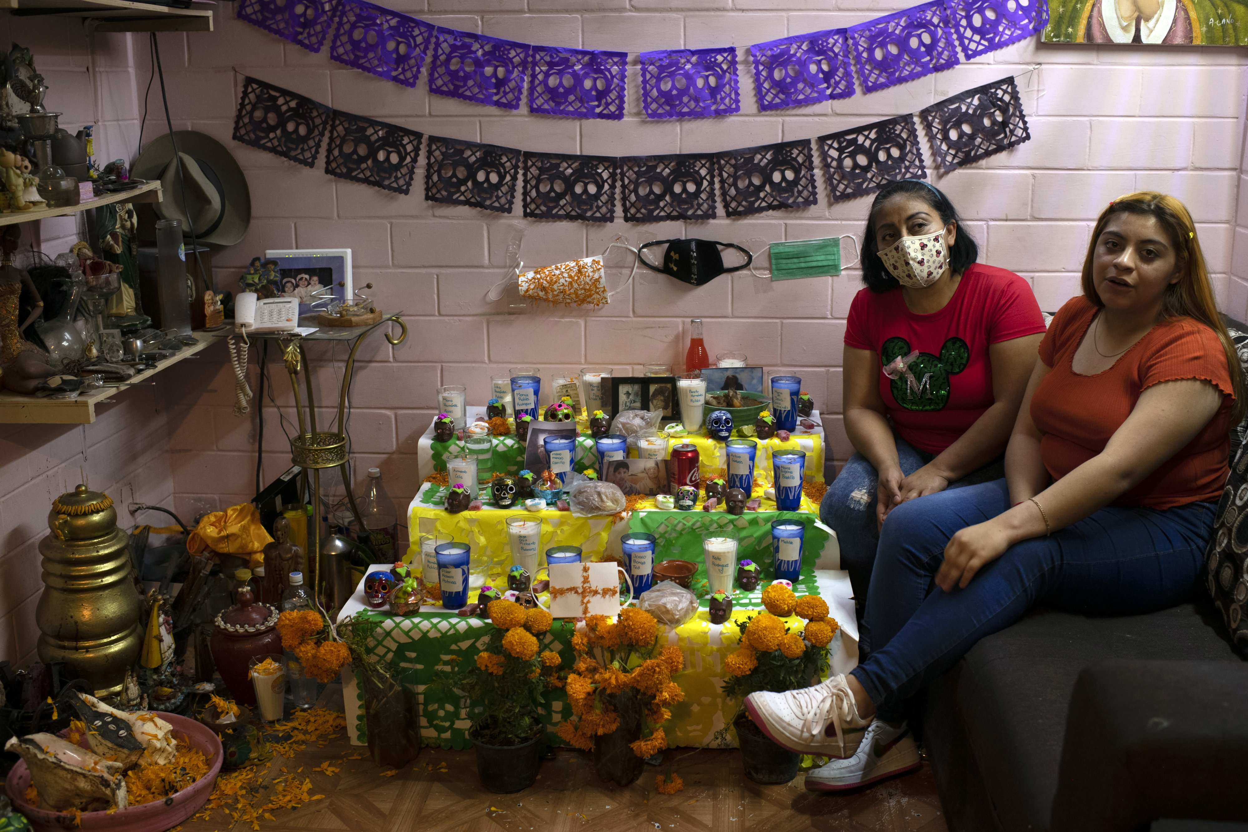 Isela Hernandez is one of the cofounders of Makalipt, a women's group from Tepito. Here she can be seen at the altar she has made.