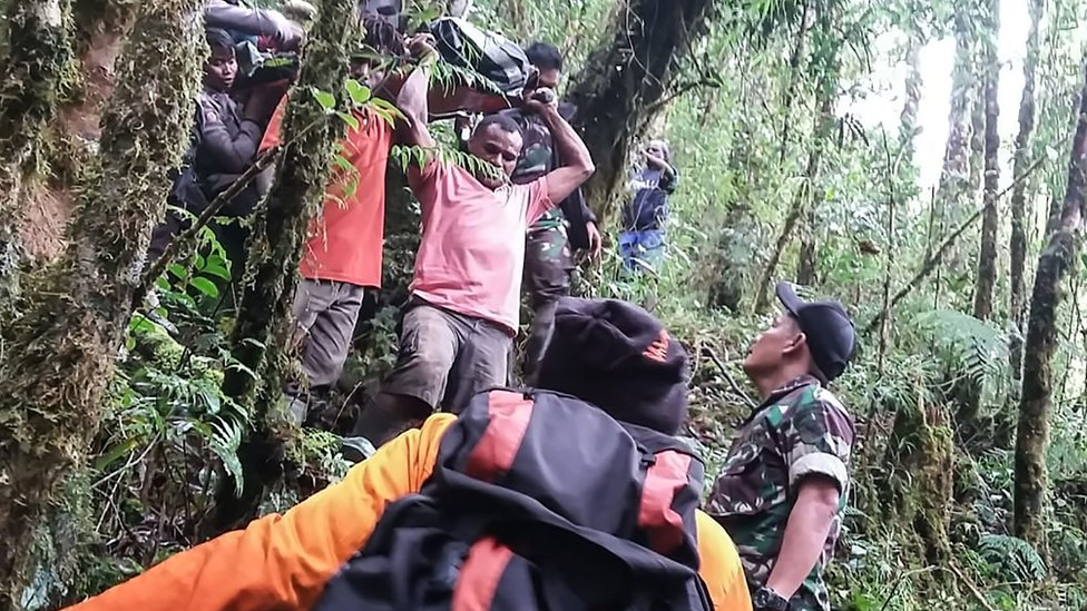Papua's Cendrawasih Military Command shows a rescue team evacuating the sole survivor from the crash site of a Swiss-made Pilatus aircraft at Menuk mountain in Oksibil.