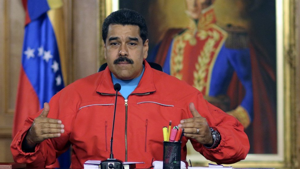 Handout picture released by the Venezuelan presidency press office showing Venezuelan President Nicolas Maduro during a press conference after knowing the first result in the legislative election, in Caracas on December 7, 2015.
