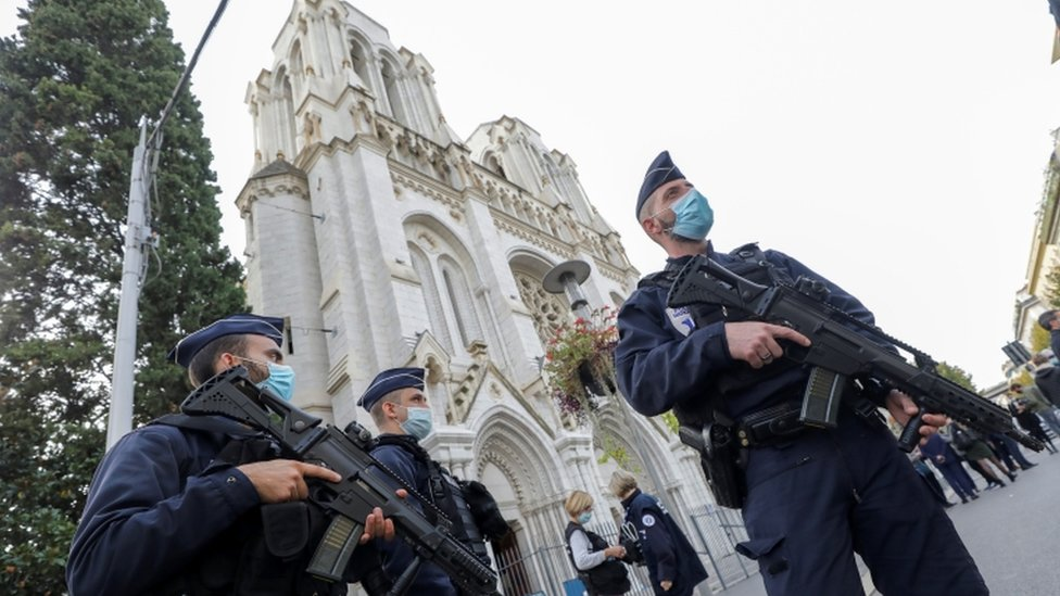 Police officers stand near the Notre-Dame basilica