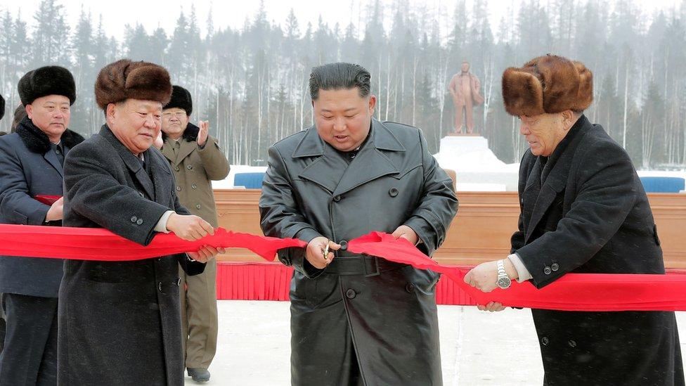 North Korean leader Kim Jong Un cuts the ribbon during a ceremony at the township of Samjiyon County