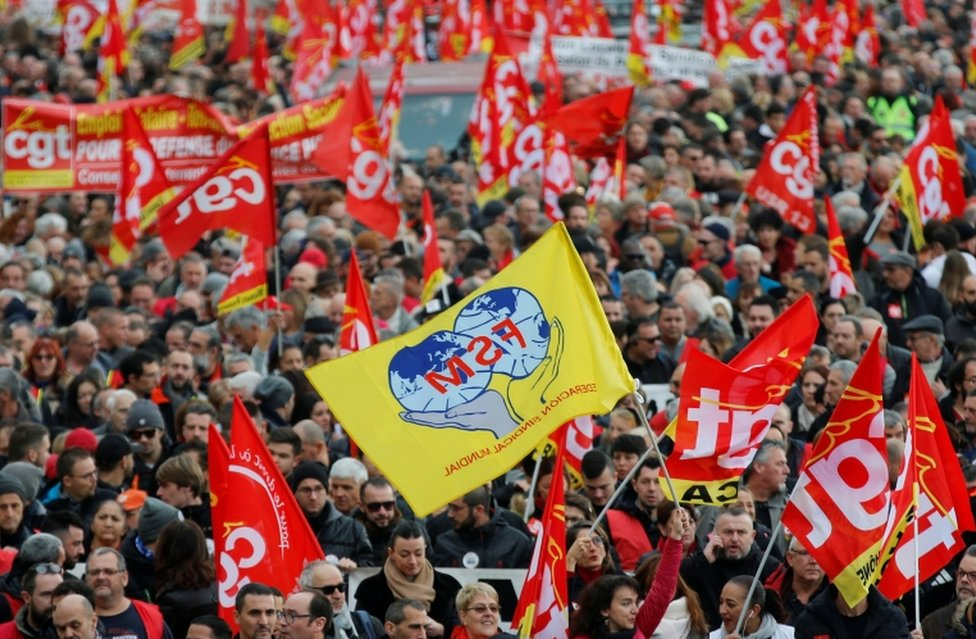French Labour union members hold flags at a demonstration in Marseille