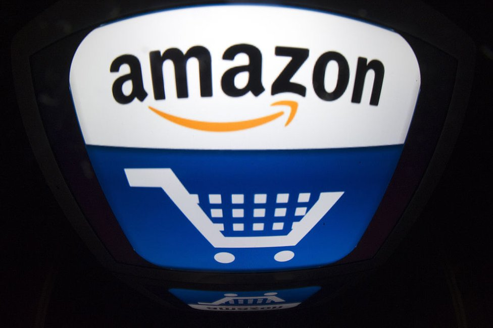The Amazon logo with a shopping basket