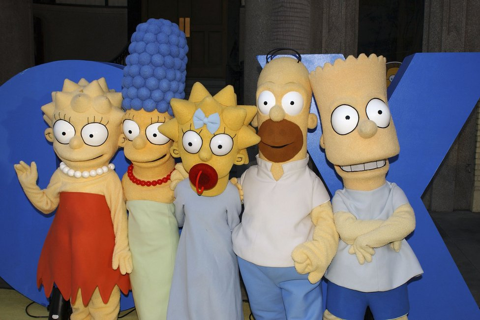 The Simpsons characters Lisa, Marge, Maggie, Homer and Bart Simpson pose for a photograph at 'The Simpsons' 350th episode block party on April 25, 2005 in Los Angeles, California
