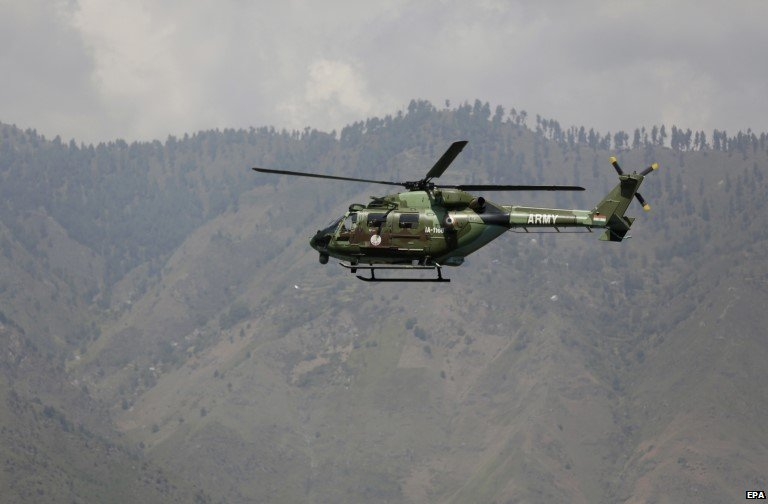 An Indian army helicopter flies above the army base which was attacked by suspected rebels in the town of Uri, west of Srinagar, Indian controlled Kashmir,