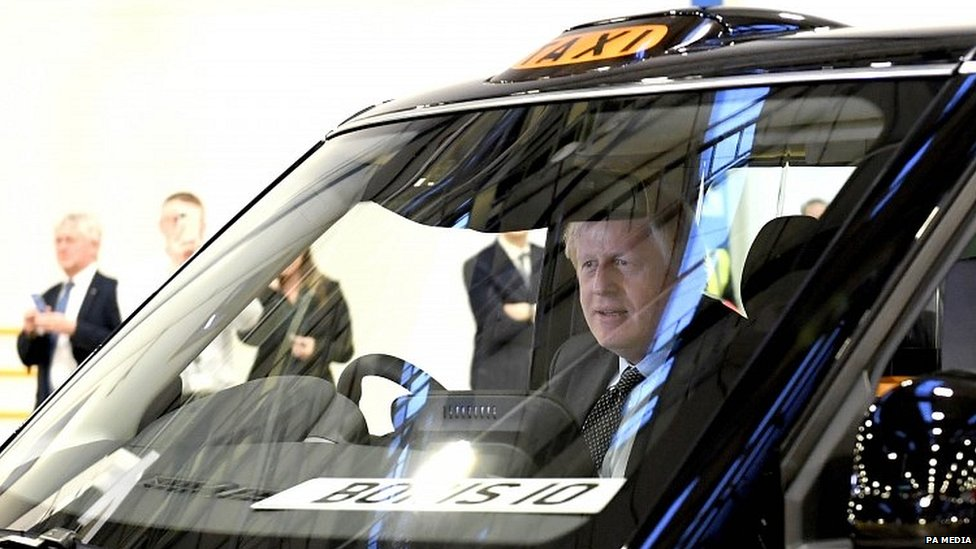Boris Johnson at the wheel of a new electric taxi manufactured in Coventry