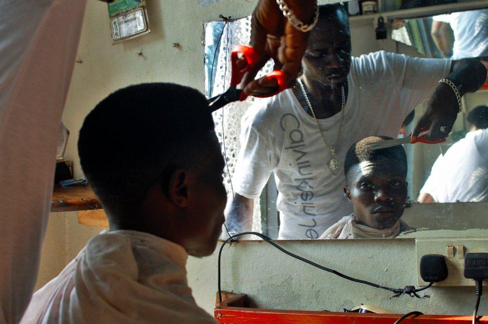 Customer having his hair cut