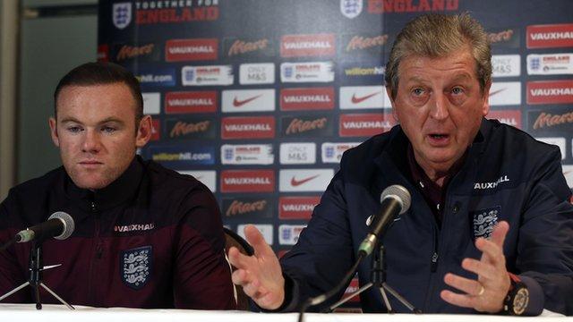 England's Wayne Rooney and Roy Hodgson