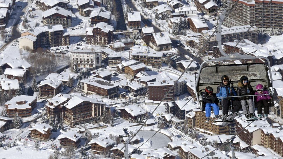 Skiers use skis lifts up the slopes at the ski resort in Val-d'Isere, in the French Alps