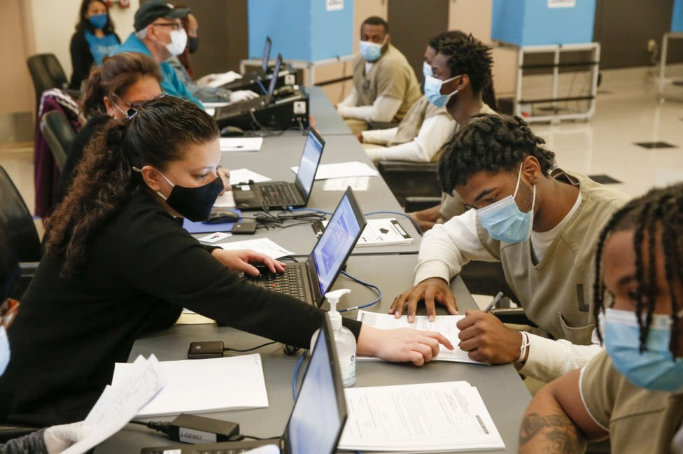 Men in Cook County Jail check in before casting their votes after a polling place was opened in the facility for early voting on 17 October, 2020