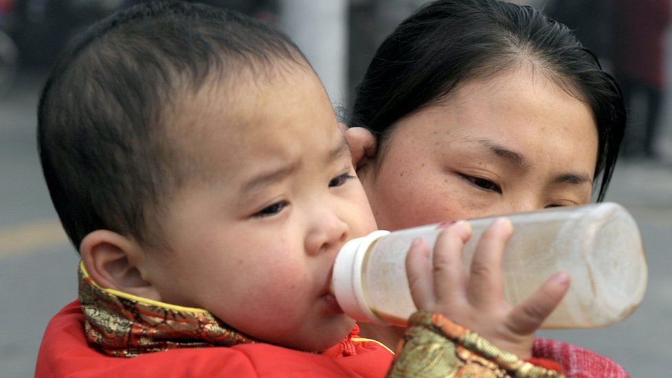A child drinking milk in Chengdu, in China's southwestern province of Sichuan