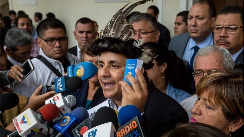 Deputy Julio Ygarza (C) speaks to the press after leaving the Venezuelan Parliament session in Caracas, Venezuela, 28 July 2016, after being sworn-in with two other indigenous deputies.