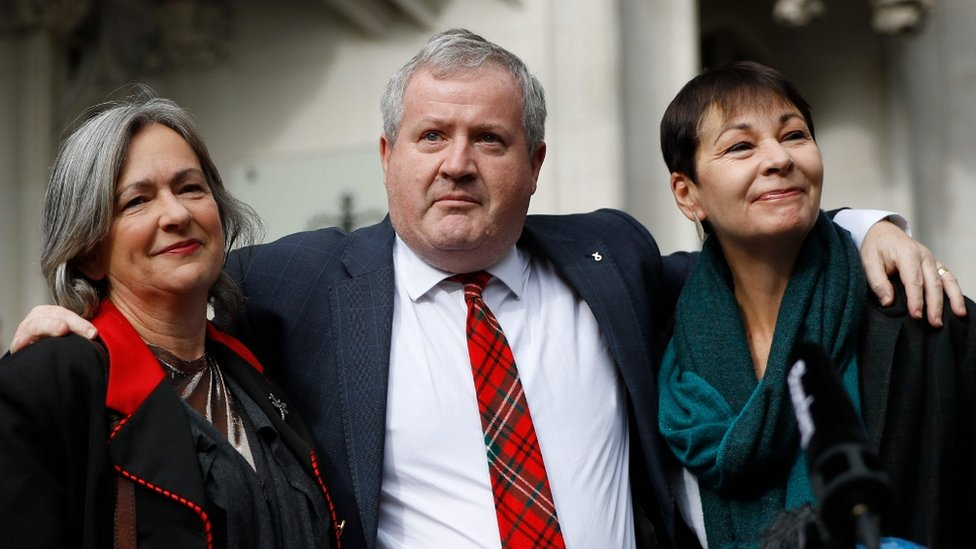 Plaid Cymru Westminster leader Liz Saville Roberts, left, Scottish National Party Westminster leader Ian Blackford, centre, and Green Party MP Caroline Lucas outside the Supreme Court