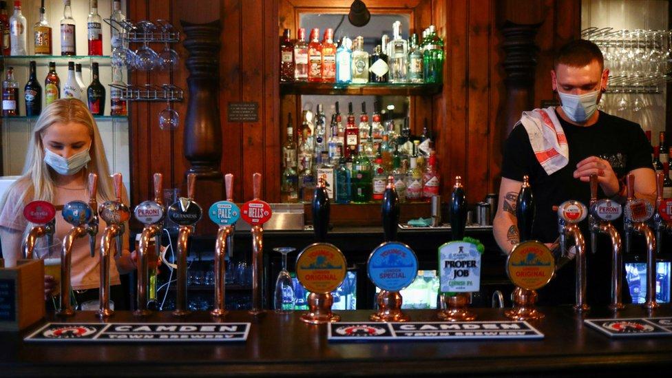 Masked bar staff in UK pub
