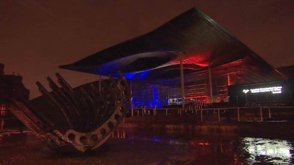The Senedd lit up with the tricolour