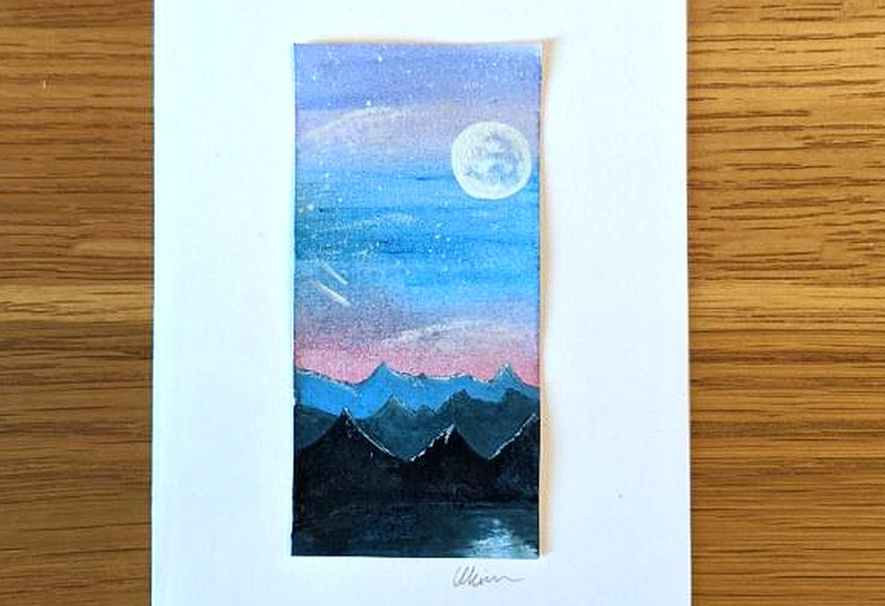 Painting of mountains and moon